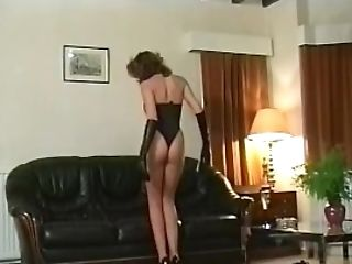 Lady In Leather Undergarments Two