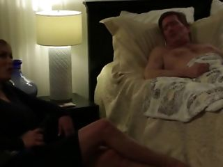 A Damsel Is Getting Penetrated By A Dude On The Sofa In Front Of His Wifey
